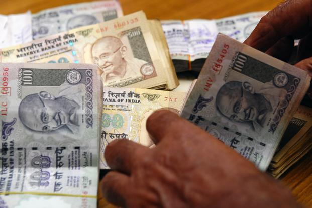 Rupee slips against dollar