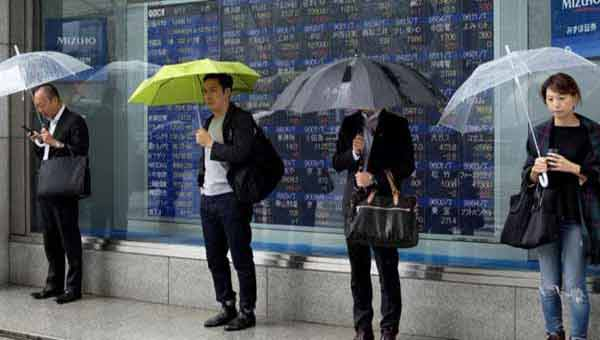 Asian markets close higher after Fed minutes