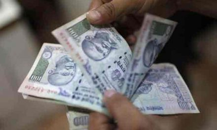 Rupee falls back into red at 65.47 against dollar